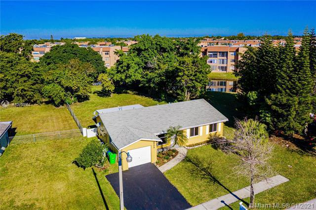 First Photo for Home For Sale at 9775 NW 26th Ct Sunrise, FL. 33322